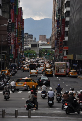 taipei traffic, motorbikes and taxis, taiwan